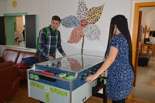 Lettice and Kiryl playing table football