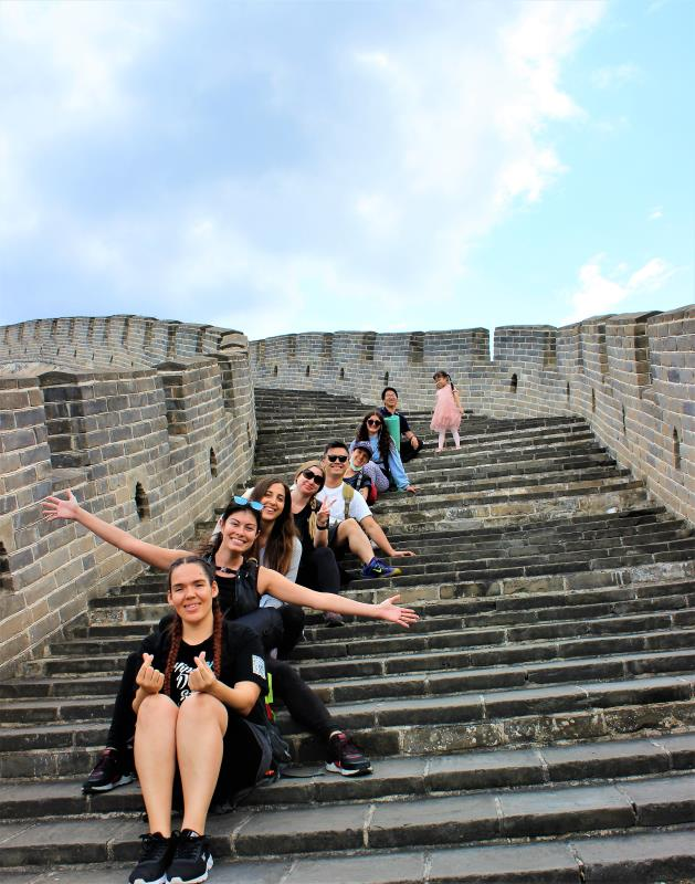 Sitting on the Great Wall of China.