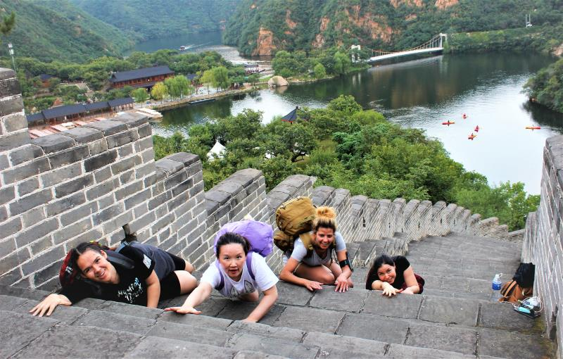 Members of Female Expats of Beijing (FEB) laying on the Great Wall of China.